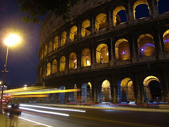 Traffic whizzing by the Colosseum