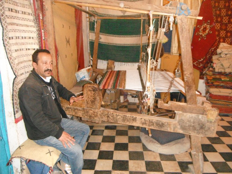 Fes el Bali, Morocco,  Chouara tannery weaver shop proprietor and loom