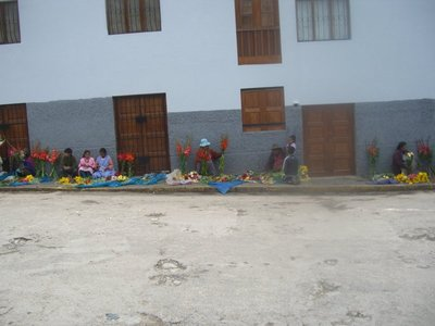 Women are sitting and selling flowers