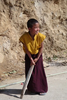 Young Monk Playing Cricket