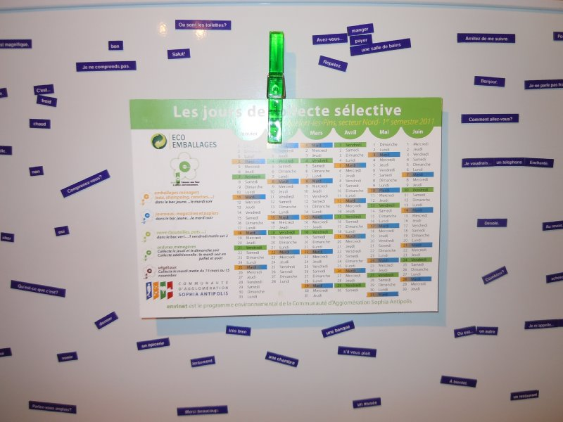 French magnetic poetry with garbage collection schedule