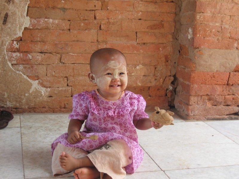 Burmese baby wearing traditional thanaka facepaint, Bagan