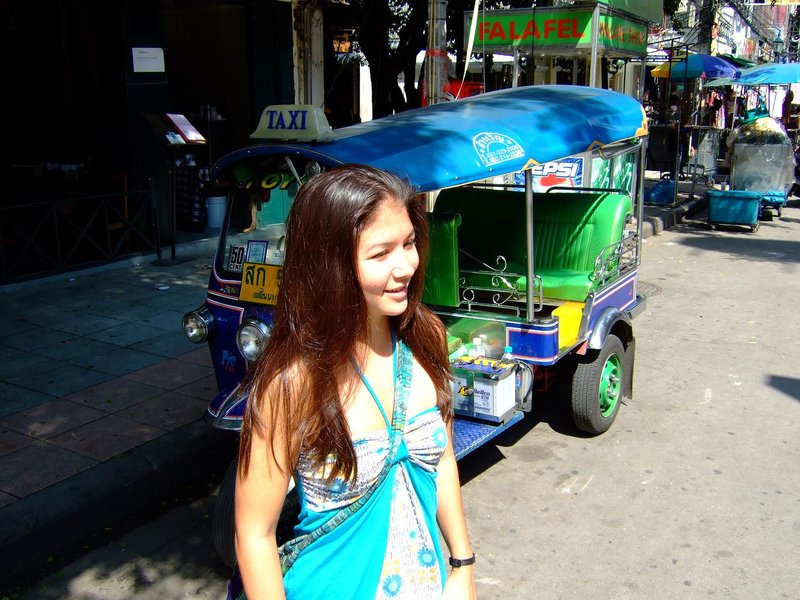 Erin in front of a tuk tuk