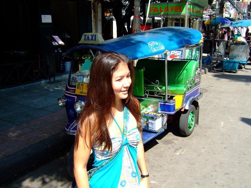 Erin in front of a tuk tuk