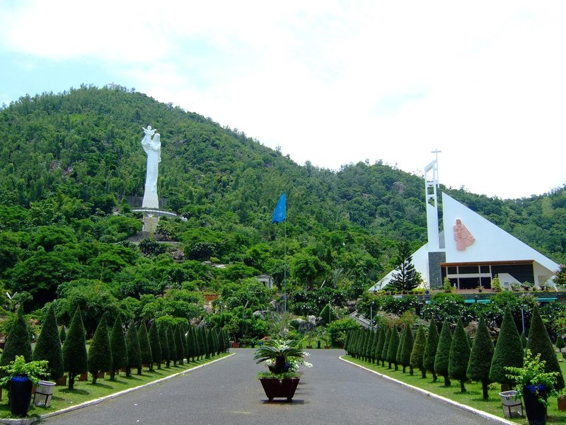 Large hillside church and statue