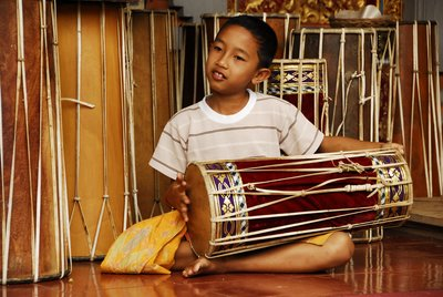 Child playing Drum