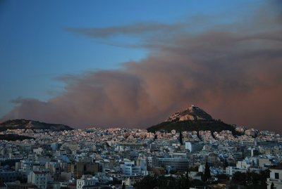 Smoke of the Forest fire dyed in Pink in Athens