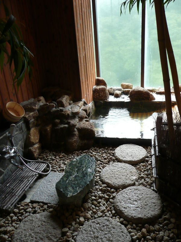 a private hotspring bathroom in a ryokan in Kawaji