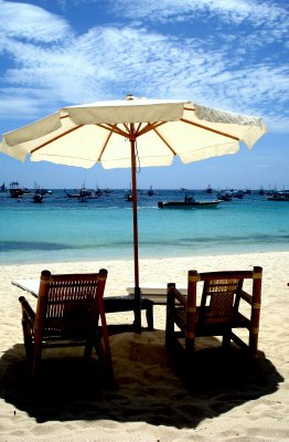 under the white umbrella in a white beach