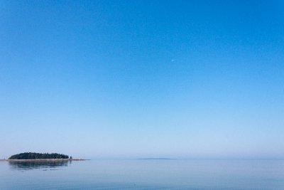 Island between sky and sea