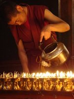 monk-filling-candles