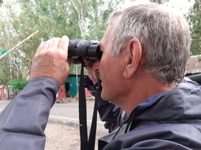 Leo with binoculars