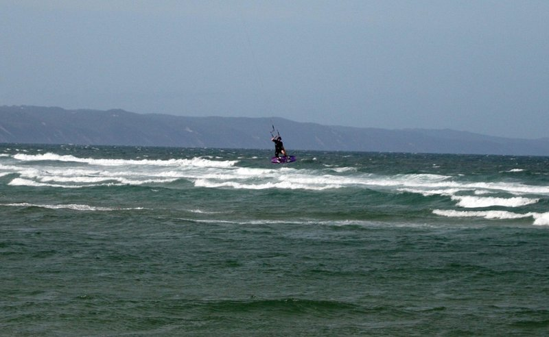 A kiteboarder launches