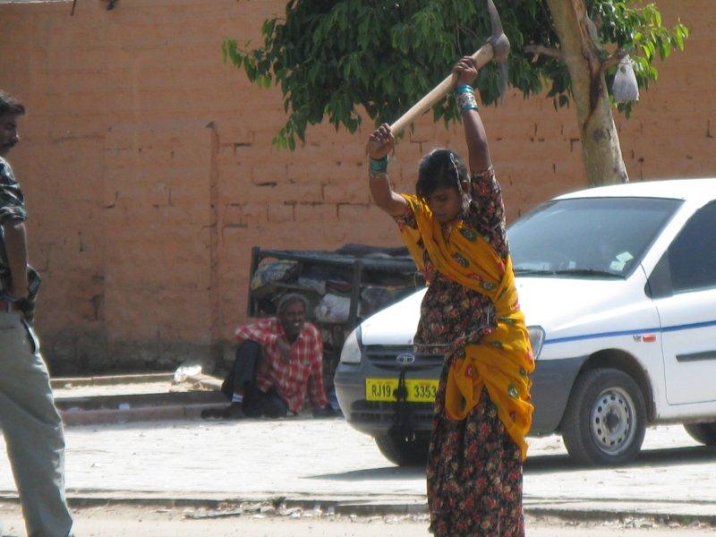 Woman digging up street in Jodhpur