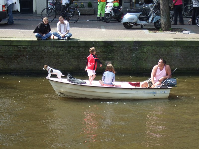 Fearless Dog on canal boat in Amsterdam