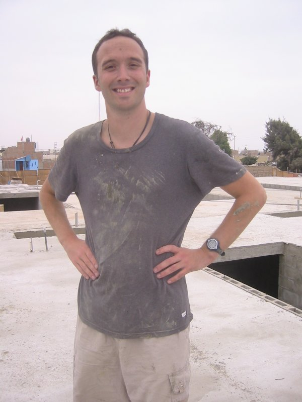 A dirty volunteer on the roof