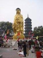 Buddha and People Praying