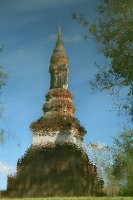 Lotus bud chedi in reflection
