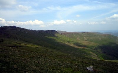 following the edge of kinder edges. woolpacks howden tower in view, grindslow knoll in distance