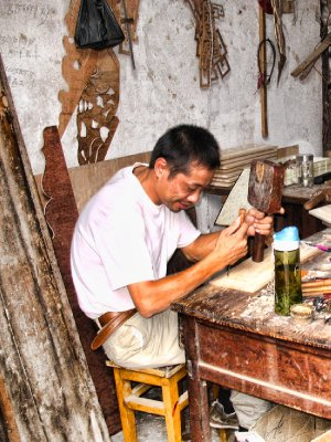 A diligent wood carver
