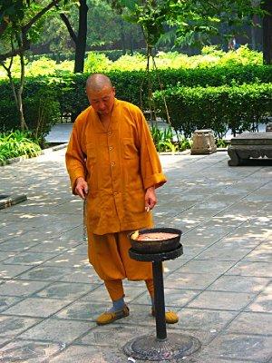 Monk doing his lighting the candle job