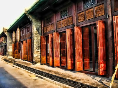 Lots of beautifully carved wooden Doors - Mao era