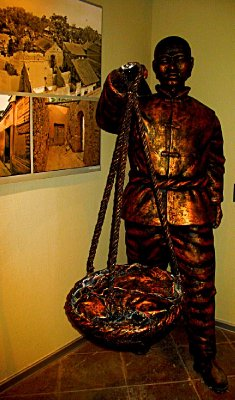 Bronze of a family worker