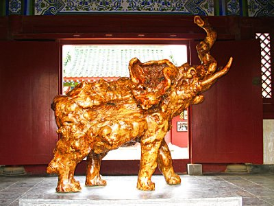 Carved wooden Elephant near the pagoda