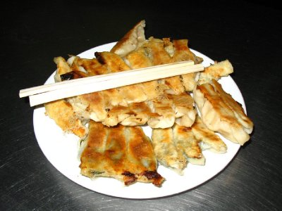 A plate full of fried dumplings or Guotieh 锅贴