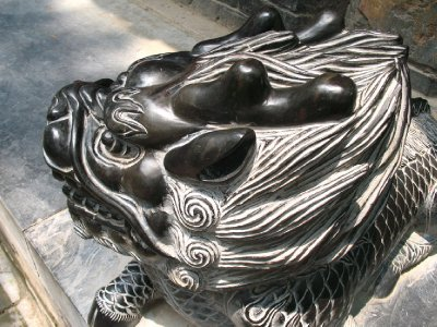 A Darkened Lion Head - Rub it for good luck