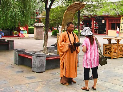 Donations to a roving monk