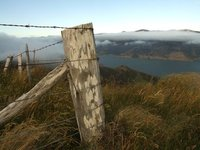 Fence post on mountain top