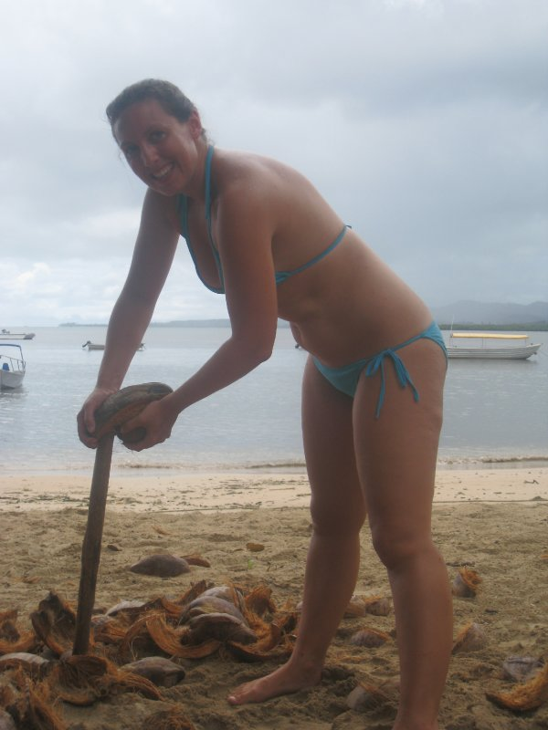 Kate Husking a Coconut