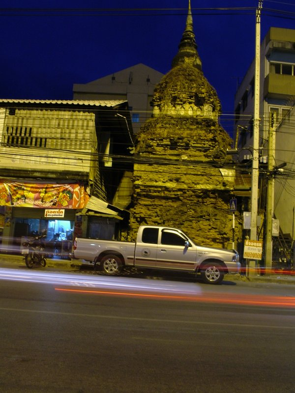 Blend of old and new, truck in front of wat. Chiang Mai, Thailand