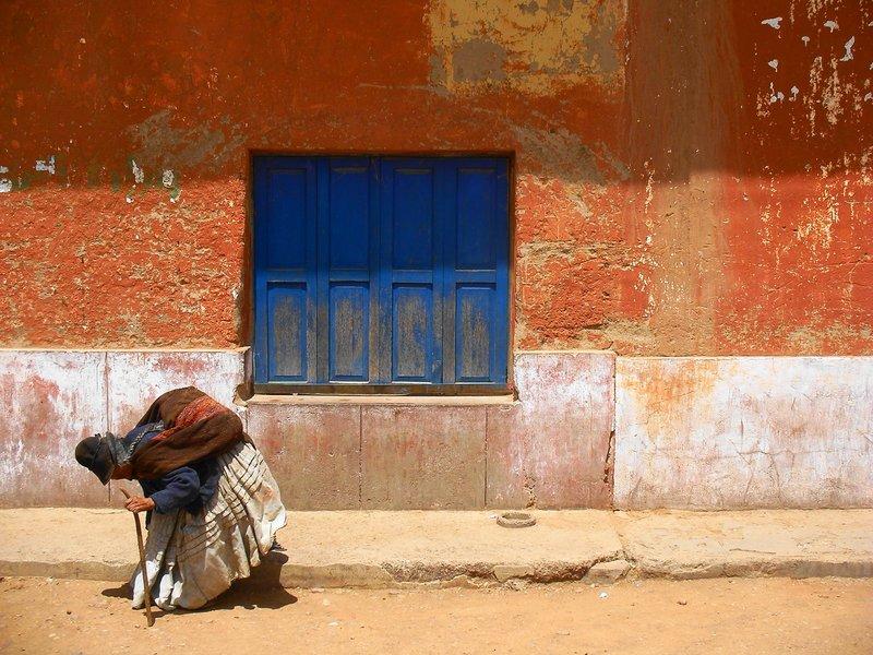 Elderly lady by roadside