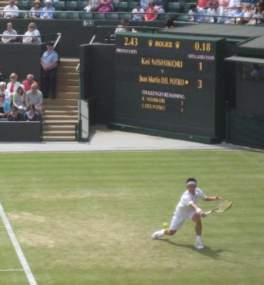 Nishikori Stretches for it on Number 1 Court, The Championship, All England Lawn Tennis and Croquet Club, Wimbledon