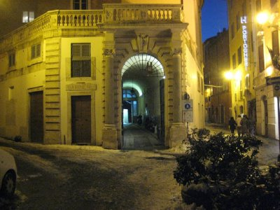 Arch and fork in the road showing the snow in Rome