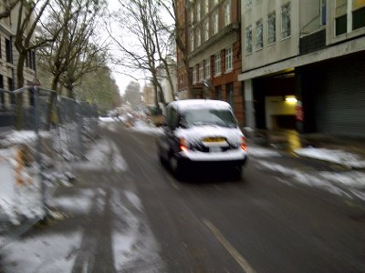 Speedy Snow Covered Taxi