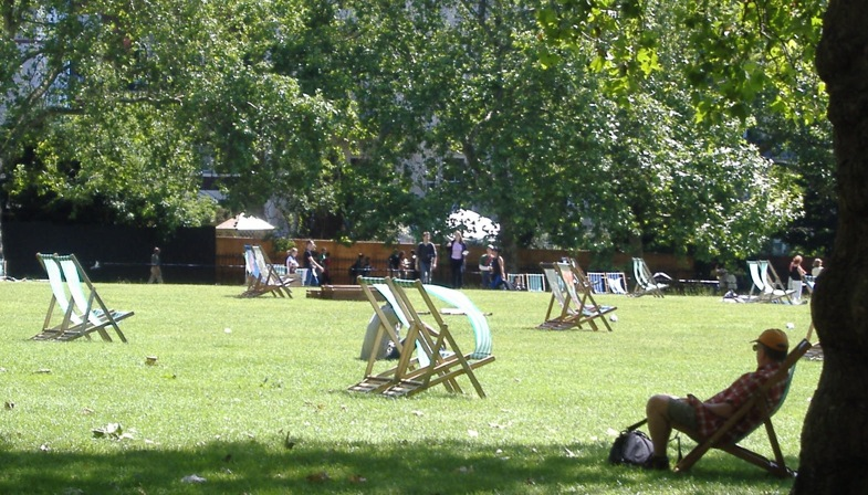 Green Park Chairs with man in shade