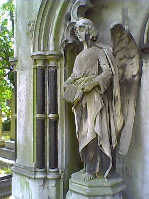Angel reading Brompton Cemetery