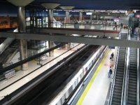 Tube speeding away at Nuevos Minsterios metro station