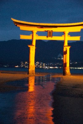 The picturesque O-Torii gate at sunset. This gate is partially submerged in the ocean during high tide.