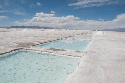 Salt is collected for human consumption and use from these pools dug into the salt flat, which are constantly regenerating themselves with new salt. Iodine is added for eating purposes.
