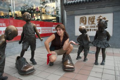 Elizabeth enjoys this shoe statue until someone on our trip told us they saw a kid peeing in it.