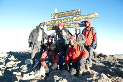 Seven Argentinians and me at the summit of Mount Kilimanjaro. From left to right, top row: Raul, Mariano, Miguel, Mariela, and Gustavo. Bottom row: me, Jose Maria, Juan.