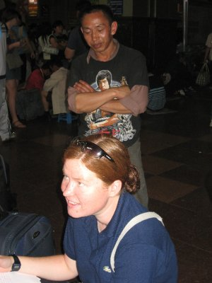 A Chinese man stands over our friend Niamh in a train station. Yup....she's white and she has red hair....a freak of nature! It was common for locals to stare at us while intensely observing our visual differences. In fact, many times we were asked to be a part of family pictures since we were so unusual!