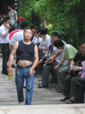 Men often walk around with their shirts up over their belly to cool off.