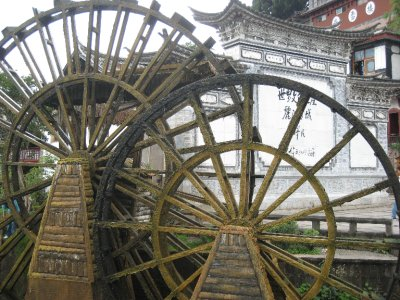 Water wheels mark the entry into Lijiang's ancient city.