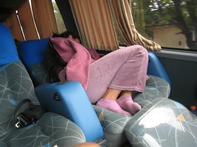 Elizabeth gets cozy for our overnight bus trip.