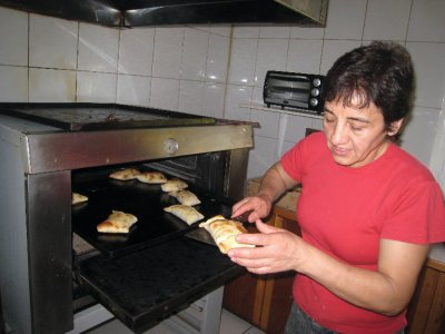 Rosalia, Valeria's cousin and neighbor, is making her award winning empanadas (pastry triangles filled with beef, egg, onions and mushrooms!)